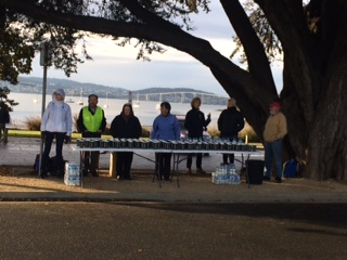 Manning the water station at Cornelian Bay.